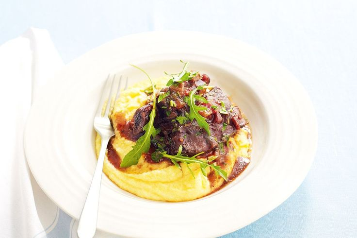 Slow cooked short ribs, braised with porcini and red wine, needs a bed of soft polenta to soak up all of the rich sauce.