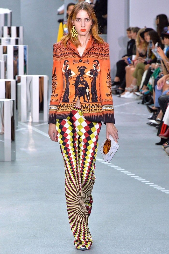 Mary Katrantzou | Thera blazer dewel – Thoukis trousers – Harlequin green/red | Mary Katrantzou combines the ancient with the hyper-modern, fusing classicism with futurism and sixties art. Ancient artefacts are warped through op-art designs, mapped across the topography of the…