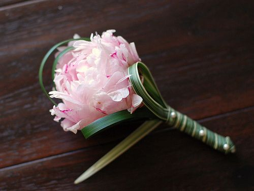 Single peony boutonneire with lily (lilly?) grass by Flowers by Shirley (http://shirleyflowers.blogspot.com).