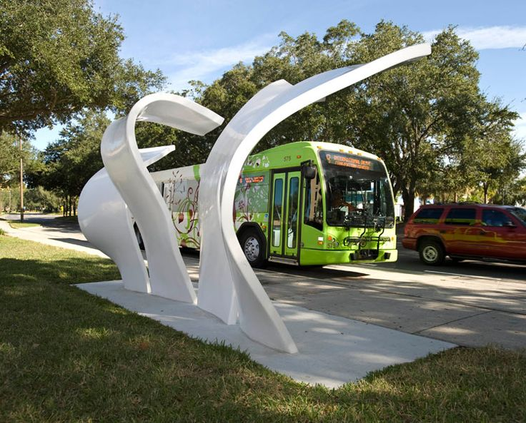 "A series of sculptural bus stops will be installed throughout Orlando as part of an effort to bring art into the community. Entech Creative, a production engineering company, teamed up with Walter Geiger, of Walt Geiger Studios, to design and produce the ""Cascade"" series of shelter structures. Each bus stop has four to five uniquely shaped panels ranging from 15 to 16 feet high. Their form is suggestive of a waterfall, undulating to provide commuters with shade and shelter."