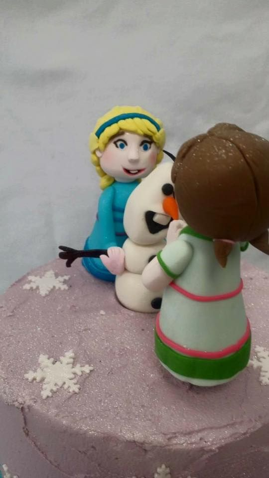 Elsa & Olaf Frozen Themed Cake Toppers modelled by Coast Cakes Ltd