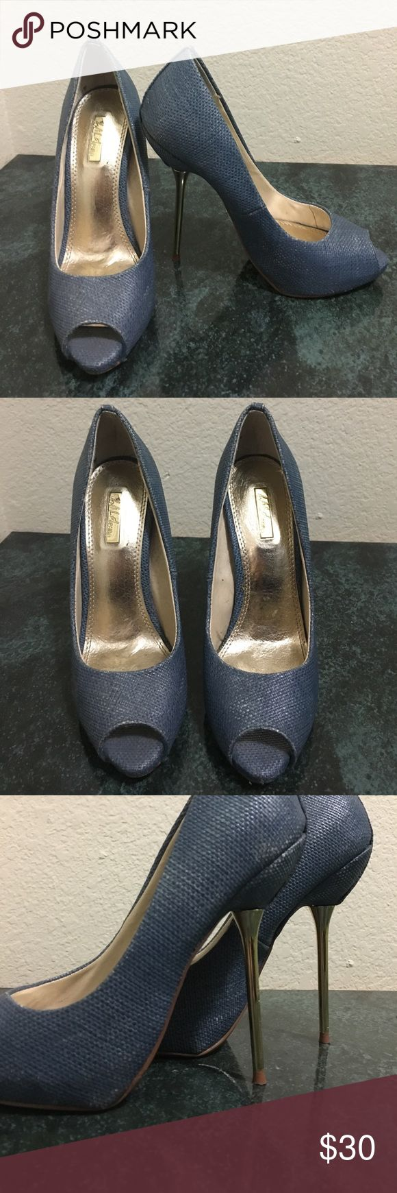 Gorgeous blue peep toe pumps with gold stiletto! These are one of my favorites ! So effortlessly sexy . Get so many compliments on these . Gorgeous dusty blue with wicker detailing . Gold stiletto heels add that gorgeous flair . Hate to let these go but really have no occasion to wear anymore . Please give them a good home ! Pre loved condition , purchased at bakers ! Wild Pair Shoes Heels