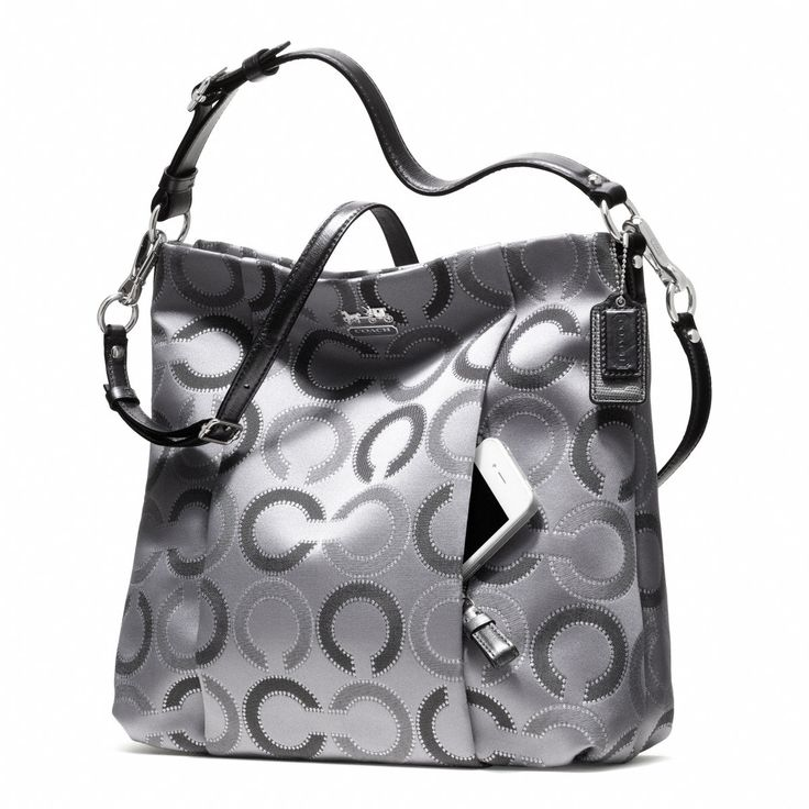 silver coach purse - I got this one last year, love it. I use the front pocket for my cell phone as well.