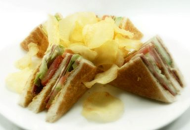 SMOKED BEEF SANDWICH. 3 slice of bread filled with smoked beef, fresh salad & mayonnaise inside. Served with potato chips.