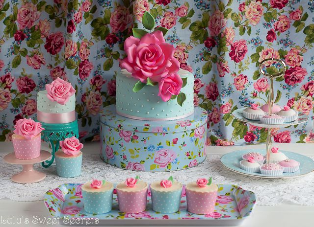 Lulu's Sweet Secrets celebrates 2 years this week. To start the  commemoration I will share with you my rose dessert table. My intention was  to create a romantic table with a lot of sugar roses.Since I started  blogging, making sugar flowers has become my passion.Every day I feel more  and more motivated to learn about them.   This table consists of one rose water and pistachio cake, white chocolate  cupcakes with rose buttercream and rose and pink peppercorn brigadeiros.  The cake rec...