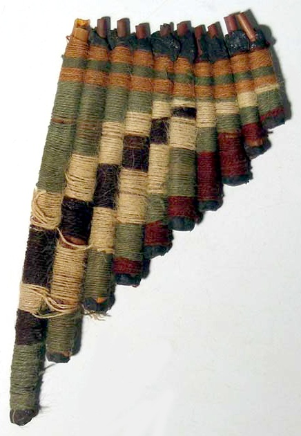 "Nazca from Peru, 400-700 AD. An extremely rare antara (pan flute). The instrument is 6"" long and is made from reed tubes wrapped with colored yarn. A truly remarkable piece!"