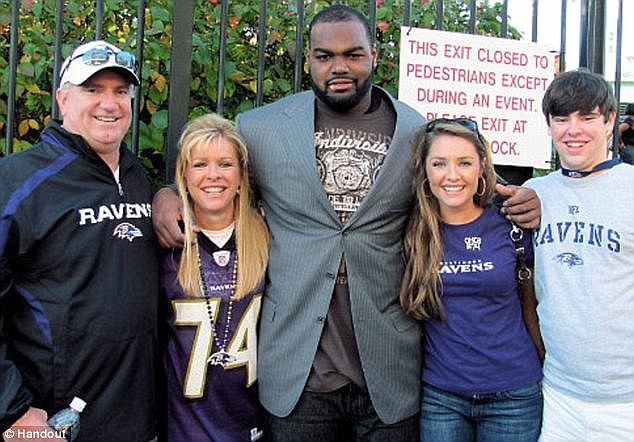 Family: Oher, however, thinks he has been downgraded as a player because of the movie. Oher pictured center with his adoptive parents, Sean and Leigh Anne Tuohy (left) and younger siblings