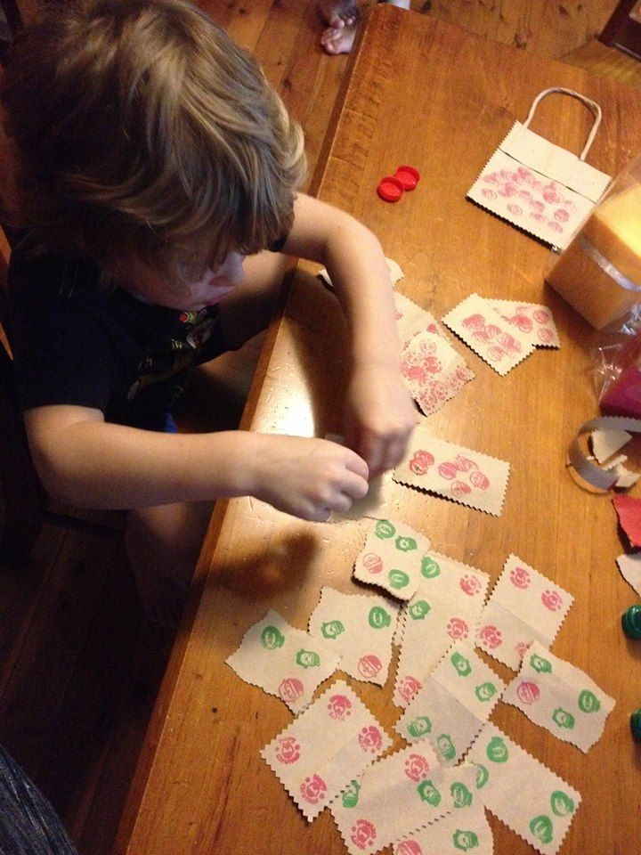 Mr 3 making some homemade Xmas tags from old paper bags and his Xmas stamps