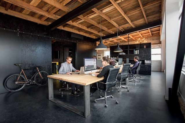 The tabletop in the main workspace is made from Laminated Veneer Lumber and the legs are blackened steel.