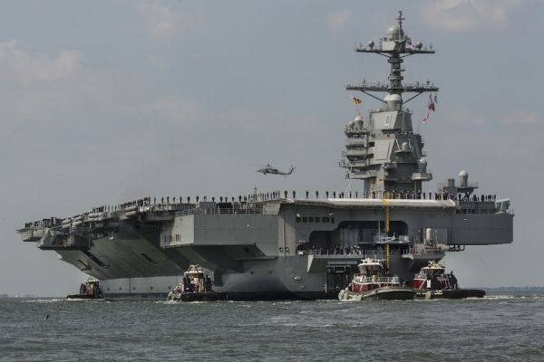 The aircraft carrier USS Gerald R. Ford heads to the Norfolk, Va., naval station on April 14, after nearly a week of builder's trials. (Bill Tiernan/The Virginian-Pilot via AP)