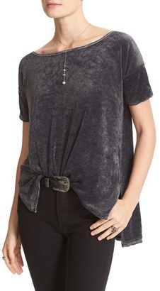 Free People Washed Velvet Tee. A special wash treatment and tattered, raw-edge trim put a grungy twist on a pretty velvet tee that's long and drapey with an exaggerated high/low hem.