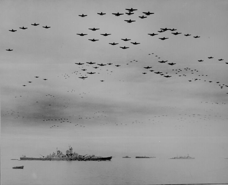 Carrier launched F4U's and F6F's fly in formation over the USS Missouri and other ships in Tokyo Harbor after the signing of the Japanese Surrender. September 2, 1945