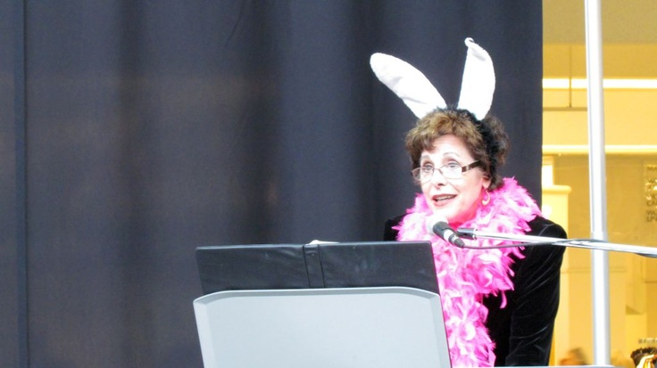 Dust Bunny at her keyboard accompanying the Mavens of Mess on-stage at Cluttermania: The Musical Revue.  GoodRidProfOrg