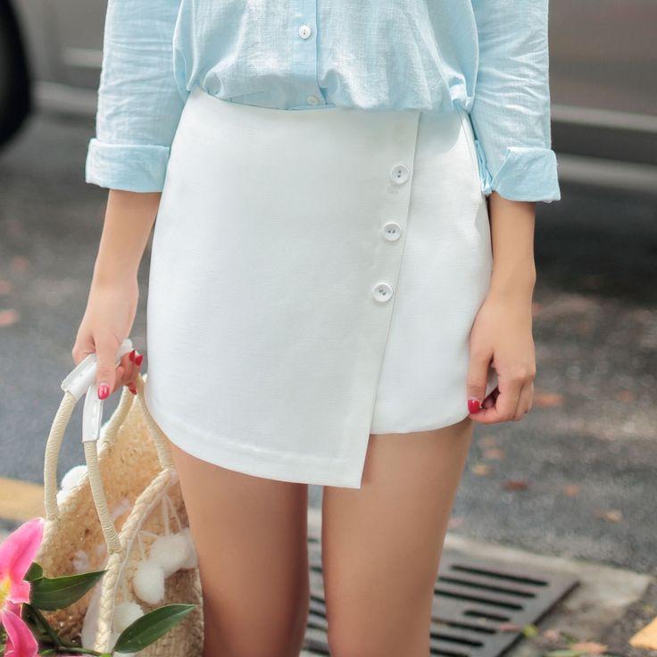 Japanese fashion wild side irregular single-breasted shorts