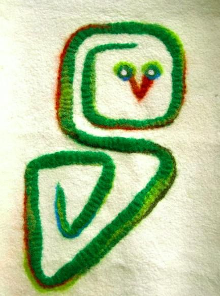 This is my logo i designed for my atelier.  I love working with fabric and felt. This is a wetfelted version of my greenowl logo.  Geskea Andriessen facebook.com/DeGroeneUil