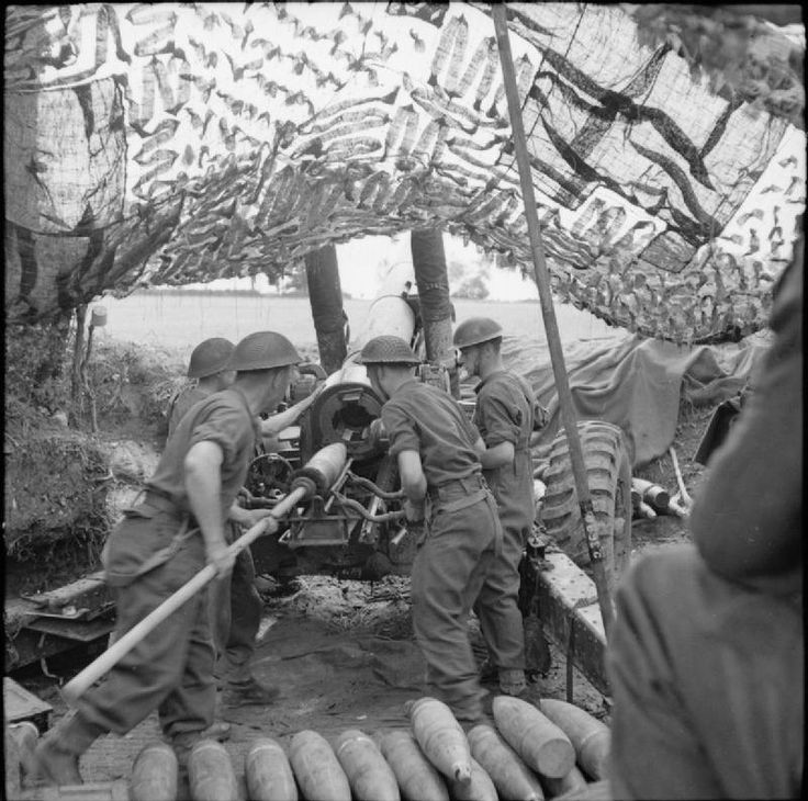 BRITISH ARMY NORMANDY 1944 (B 6295)   A shell being loaded into a 5.5-inch gun, 2 July 1944.