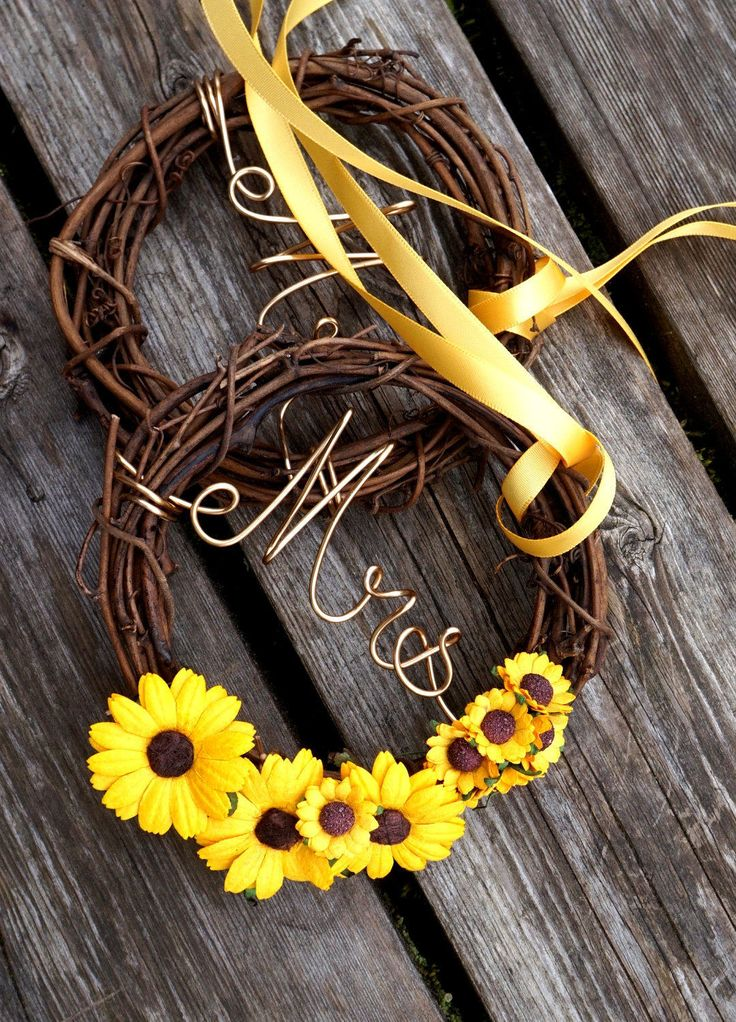 A bright and unique addition to your sunflower wedding reception decor. This pair of vine chair signs is just right for your cottage chic or Fall wedding! Listing is for a set of two vine chair back signs are scripted to say Mr & Mrs for the new couple's chairs. Or personalize with the script you would like from the drop down menu. Can be ordered with or without sunflowers. Made to order from grapevine, each piece is approximately 8 inches in width. Finished with matching satin ribbon for…