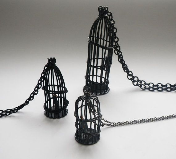 Bird cage pendant with tiny business man matte by StudioMETHODE, $205.00