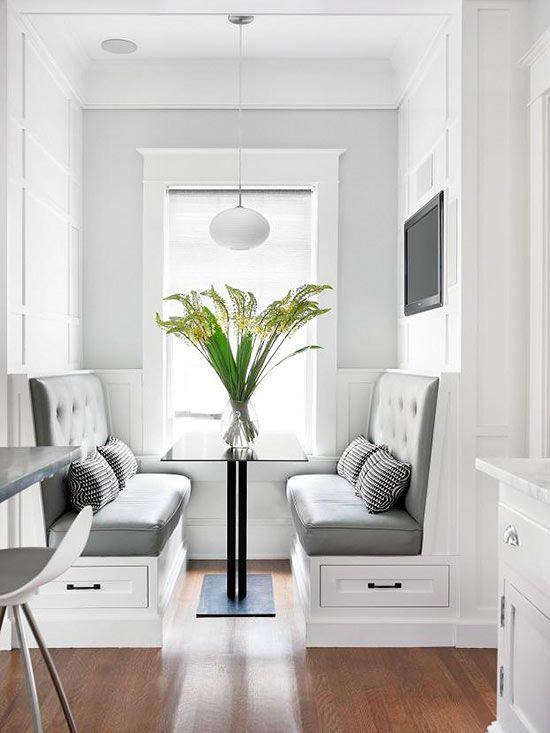 Beautiful Banquette A new custom-built banquette adds convenient seating within the kitchen. With classic wood paneling and molding, the bump-out looks as though it is straight from the '20s. The color combination of white and gray leaves the space feeling elegant and timeless.