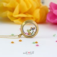 CINCO DE MAYO LOCKET Add some south of the border flair to your wardrobe with this Cinco de Mayo inspired locket! This locket features a Large Matte Gold Locket, the fun Margarita Charm, the colorful Maracas Charm and the August, October and November Birthstone Crystals.