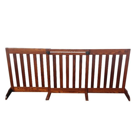 Free Standing Wooden Pet Gate How long has that old plastic baby gate been driving you crazy? Finally, there's a stylish and sturdy alternative – Wooden Furniture indoor dog gates! Easily adjustable for your convenience and strong enough to keep your dog where they need to stay even the