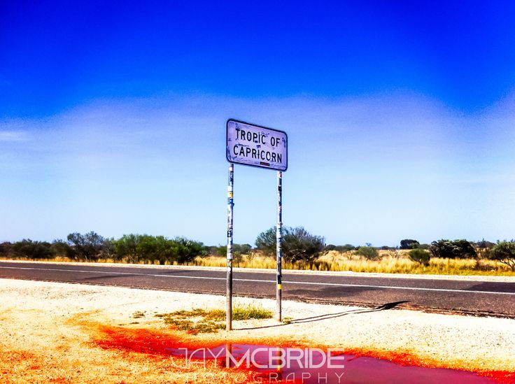 """Tropic of Capricorn by Jay McBride on 500px""""Tropic of Capricorn"""" The Tropic of Capricorn boundary in the north of Western Australia. #water #australia #blue #deserted #highway #iphoneography #nobody #north #outback #road #sky #stickers #travel #travelling #trees #tumbleweed #tropicofcapricorn  More: https://500px.com/photo/99396895/ & http://jmpevents.com.au"""