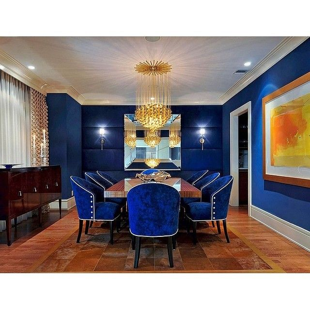 Royal blue on velvet chair and wall are perfect to combined with gold chandelier for your formal dining room. | Credit to: Carolyn Miller Interiors
