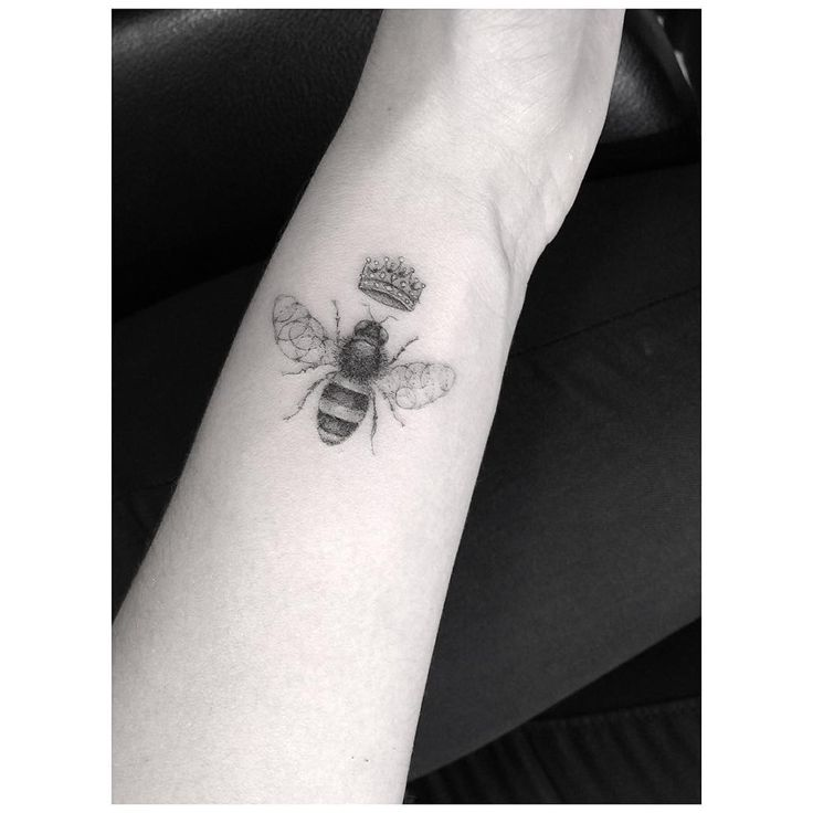 a subtle queen bee tattoo