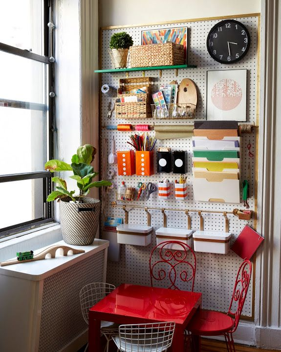 Peg board craft wall in a tiny Brooklyn apartment. Check out the rest of the apartment, great use of a small space.
