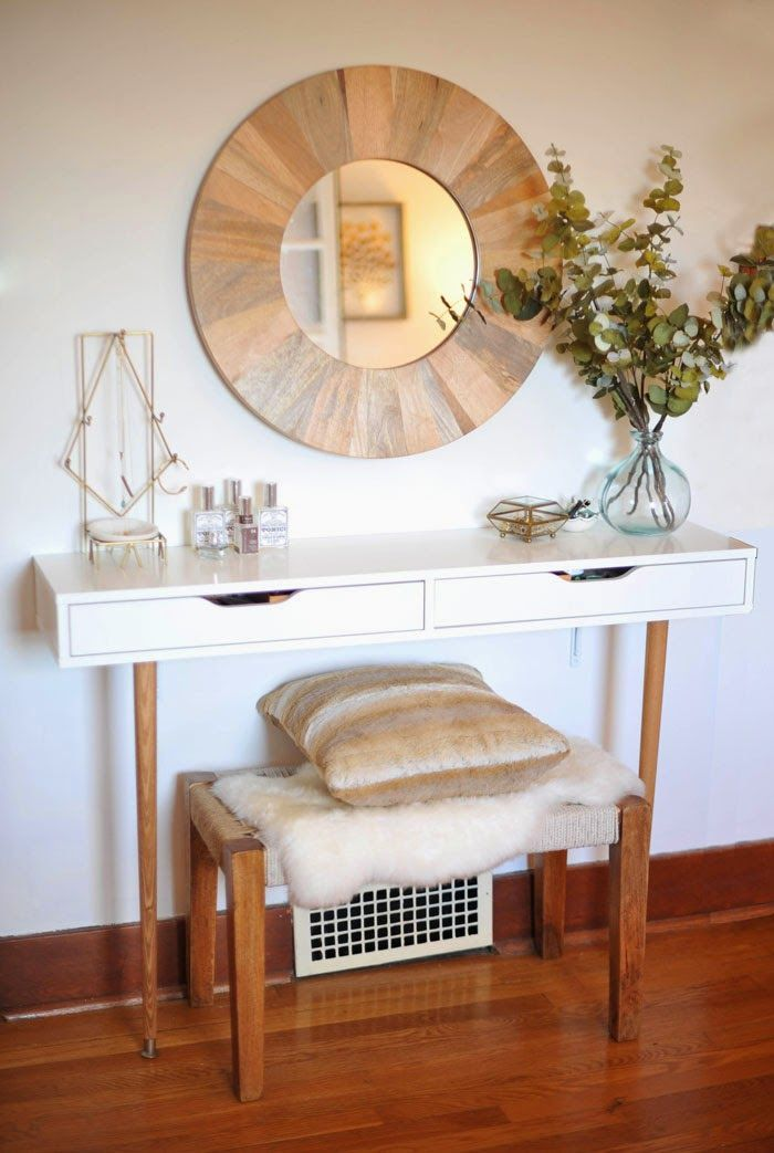 If you're looking for a chic alternative to your standard vanity, check out this super-glam creation. The blogger paired the EKBY ALEX shelving with old-school wooden legs and a sheepskin-covered bench to create a gorgeous place to spend your mornings. See more at A New Bloom »   - HouseBeautiful.com