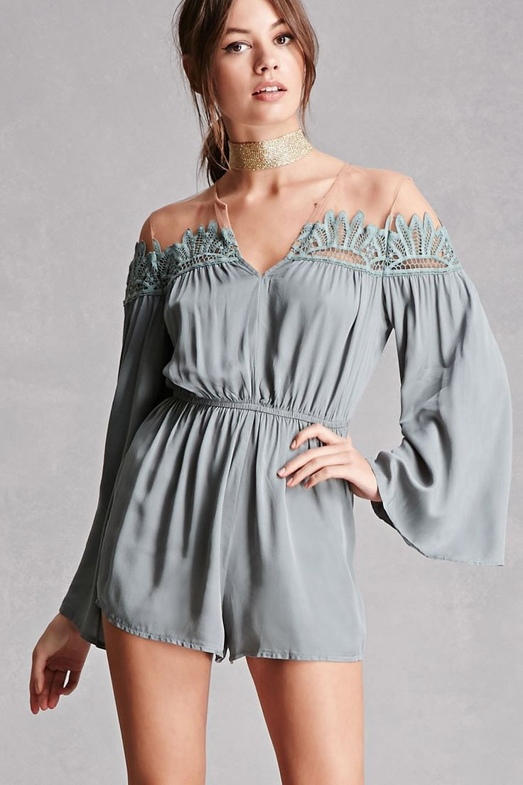 This romper by Selfie Leslie&trade features a woven fabric with mesh paneling at the shoulders and back, crochet embellishment along the top, long bell sleeves, a split neckline, elasticized waist, and a concealed back zipper.