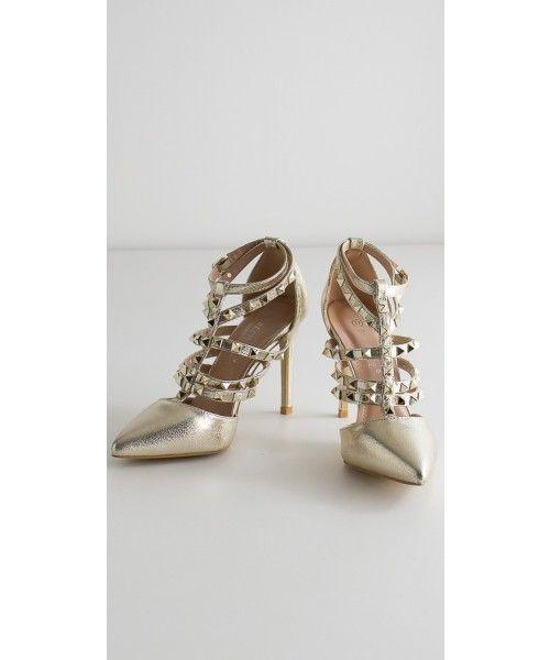 Sandalo in ecopelle con borchie e tacco altezza 10cm. Disponibile in oro e argento.