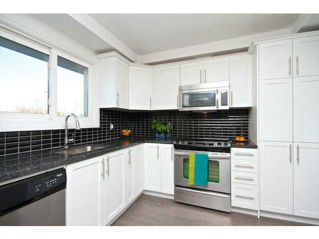 Clean & fresh kitchen with WHITE cabinets!