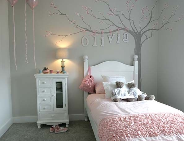 Little Girls Room – Blossom Tree Wall Mural. Such a simple yet very effective design. I hand painted the blossom using soft tones of dusty pinks and I then painted the blossom tree in a mink colour. The tree was painted in the corner to stretch over the bed and then wooden letters with ribbon were pinned to the painted branch. This mural was painted for Davidsons Homes in Nuneaton, by Carren Lu (Artistic Touch)