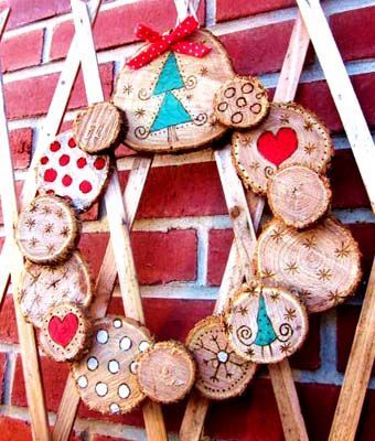 log slices arranged in wreath form, designs on wood are burned in with wood burner tool & then painted