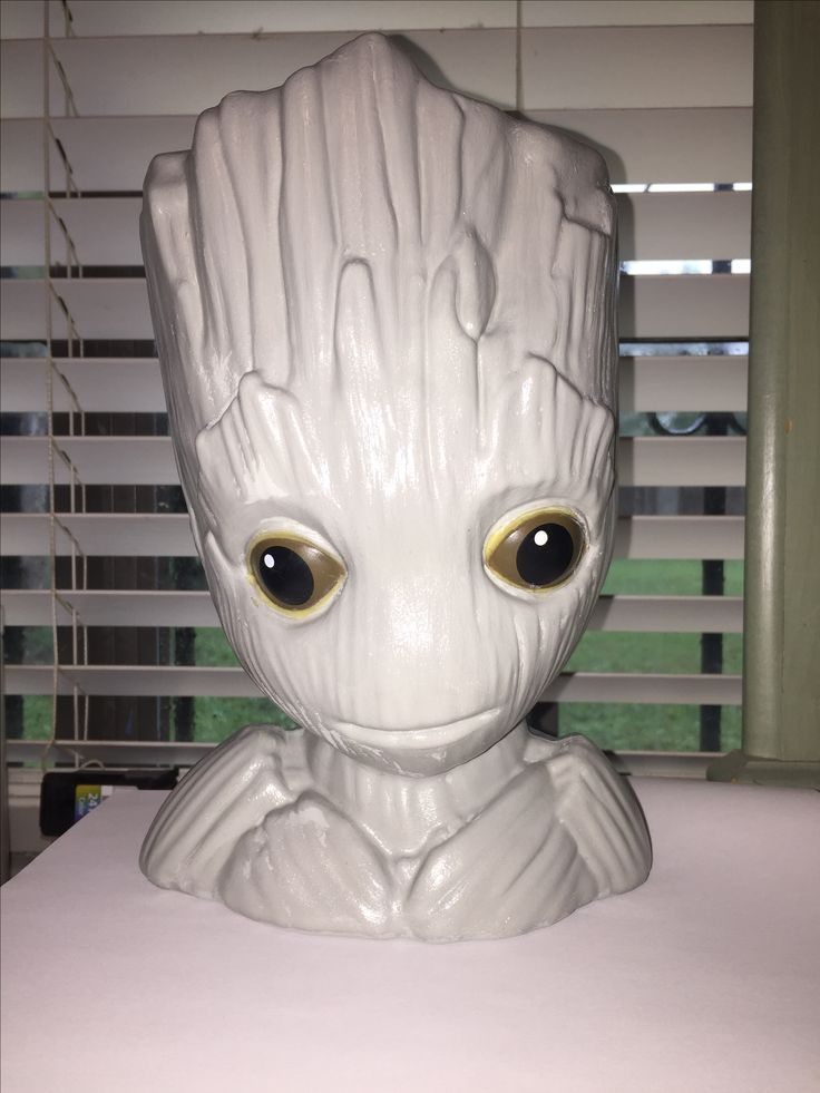 Used acrylic paint and mod podge to convert my Groot popcorn tub into an indoor flower pot.