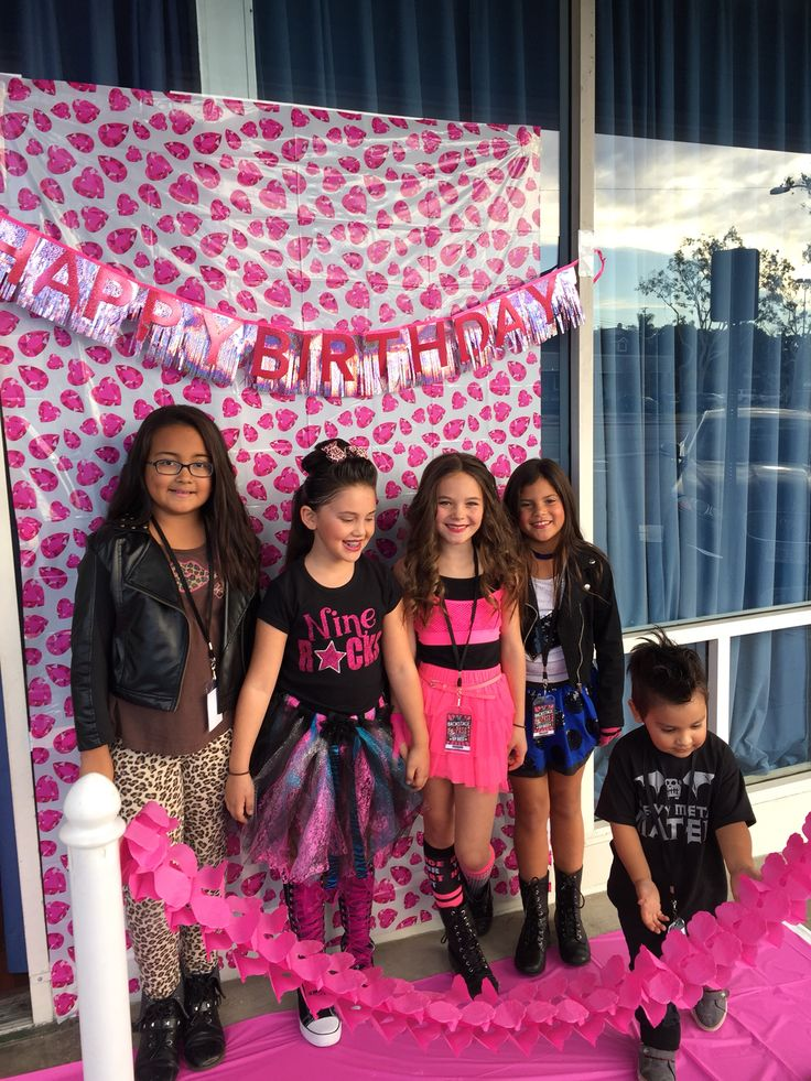 "Girls Rock Star Birthday Party - Guests walked the pink carpet and struck a pose for the paparazzi. Used printed plastic table cloths for backdrop and ""carpet""."
