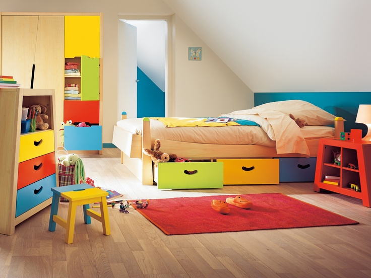 Calico Single Bed with Drawers    A fun and vibrant single bed with 3 colourful under bed drawers for valuable storage. Children will love this cheerful bedroom furniture and the Calico range is unique. Beautiful solid wood furniture with a lime wood veneer and bright green, yellow and blue lacquered panels.