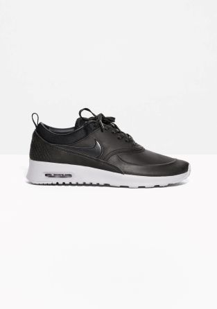 Nike swoosh logo Max Air cushioning Exposed air sole unit in the wedge Durable rubber outsole