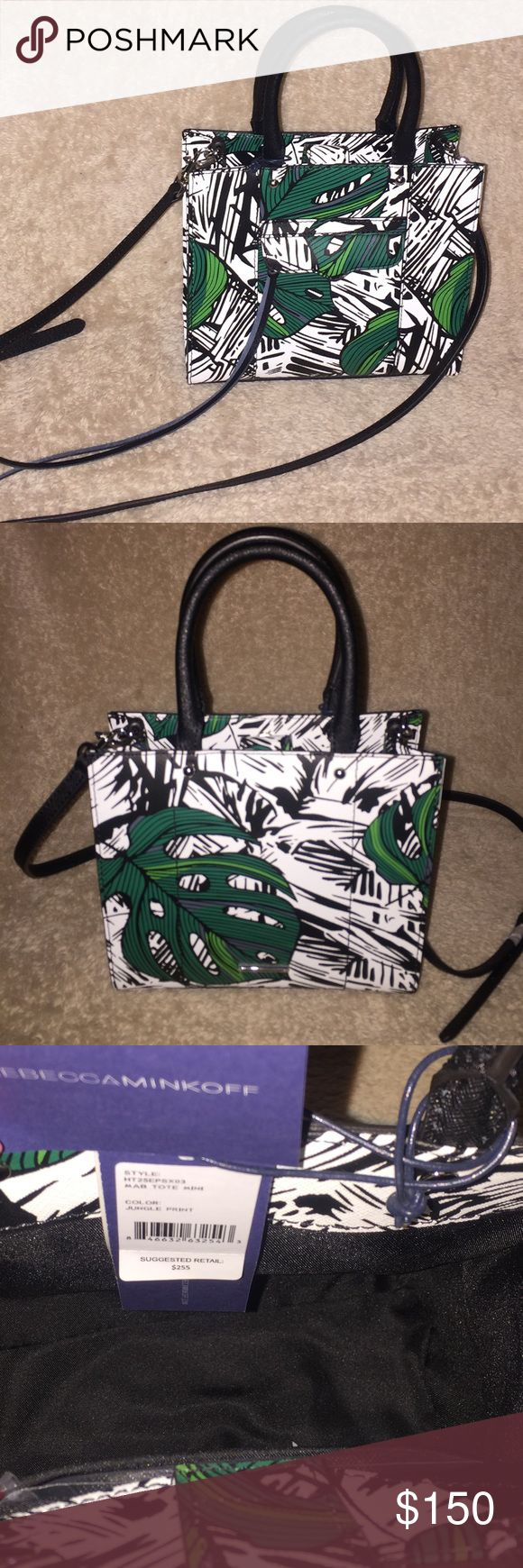 Rebecca Minkoff MAB Mini Tote Bag - Jungle Print CONDITION: New, never worn & shows no visible signs of wear. DESCRIPTION: Authentic Rebecca Minkoff MAB Mini Tote Bag - Jungle Print  DETAILS: Scaled-down version of The signature MAB tote, detailed with a tropical print. A tassel pull closes the zip front pocket, and a magnetic snap secures the top. Lined, one-pocket interior. Rolled handles and detachable shoulder strap.  ADDITIONAL INFO: Duster IS included, adjustable Strap Drop: 55cm…