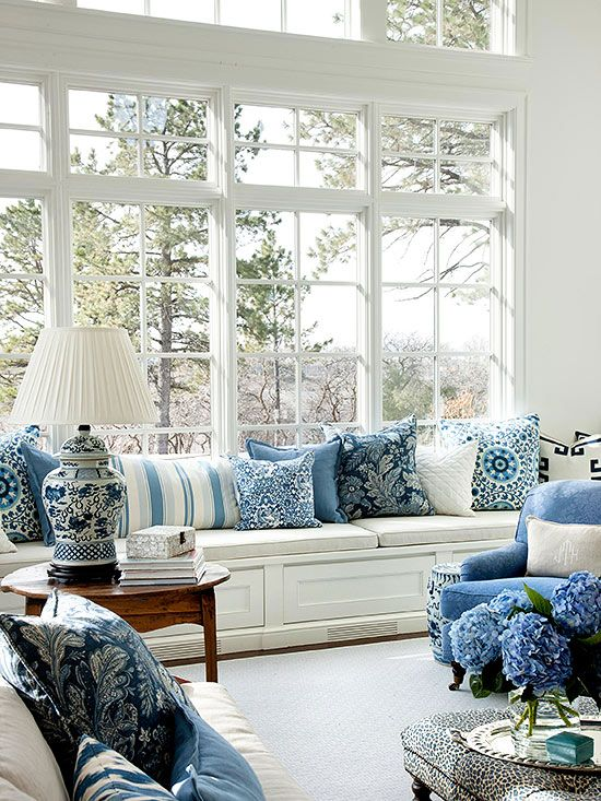 Better Homes and Gardens A great example of how fresh and crisp blue and white can be with a wonderful window seat and lots of blue and white pillows. The blue and white Chinese porcelain lamp and a b