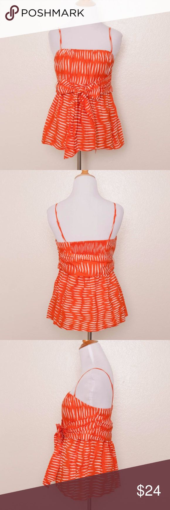 "We Love Vera Salitre Top ""Salitre Top"" Orange and white print, strapless blouse with waist tie Includes removable spaghetti straps Silicone non-slip band Smocked, elasticized inset at back 100% Cotton Machine wash Made in China  Measurements: Bust: 30"" (unstretched) Waist: 28"" Overall Length (from top of bodice to hem): 18""  Condition: Top is clean and shows minimal wear; no holes, stains, pulls, or pilling. Anthropologie Tops"