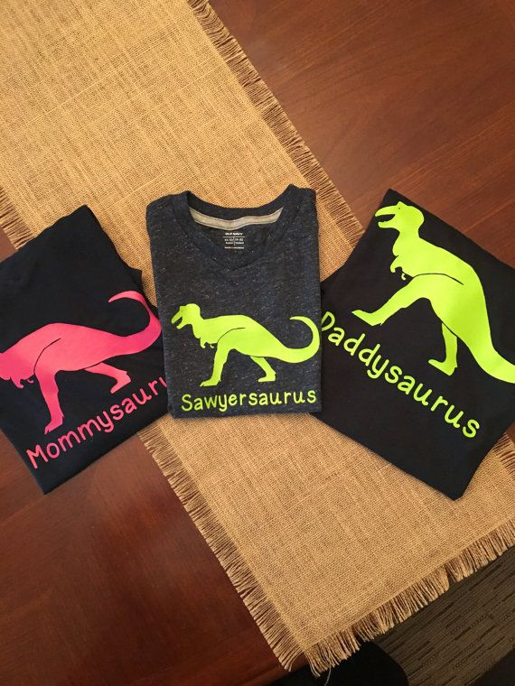 My grandson just turned three, and he absolutely loves dinosaurs! So, for his birthday this year, we went all out with the dinosaur theme.  I made him, his mom, and his dad these dinosaur t-shirts to wear, and they absolutely loved them!  This listing is for a set of three dinosaur family t-shirts: a mommysaurus, a daddysaurus, and a __________saurus, with your childs name in front of saurus.  My shirts are made with the highest quality heat transfer vinyl, and pressed with a commercial…