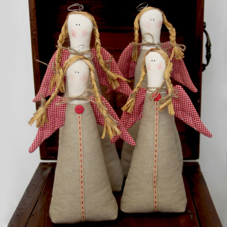 Fabric, triangular, table angels in beige and plaid red wings, decorated with ribbon and buttons.