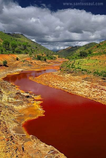 Rio Tinto [red river], Huelva, Spain. The red color come from the iron deposits present on the Earth in this area. Iron mines were opened by the Romans Ailleurs communication, dotations, voyages, jeux-concours, trade marketing www.ailleurscommunication.frmore than 2000 years ago.