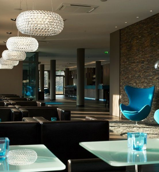 The iconic Caboche family from Foscarini with its clear or gold methacrylate spheres. www.italian-lighting-centre.co.uk