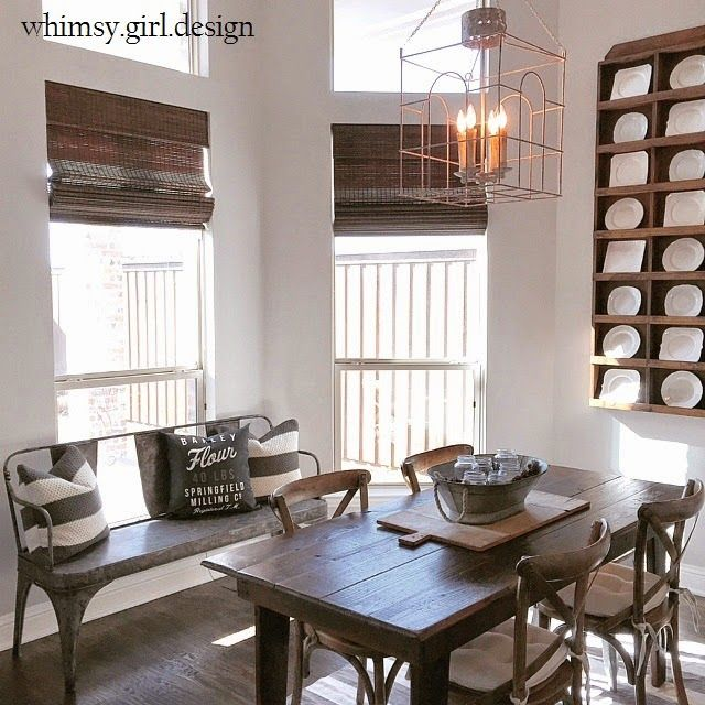 whimsy girl: {Designer Spotlight: Kathy Kuo} + a giveaway Famrhouse kithchen with indistrial elements, antique harvest table, bamboo shades, dark hardwood floors, cafe chairs, metal cafe bench, antique plate rack, bread board, galvanized metal centerpiece, cage lantern.