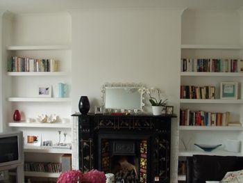 Victorian fireplace living room shelves