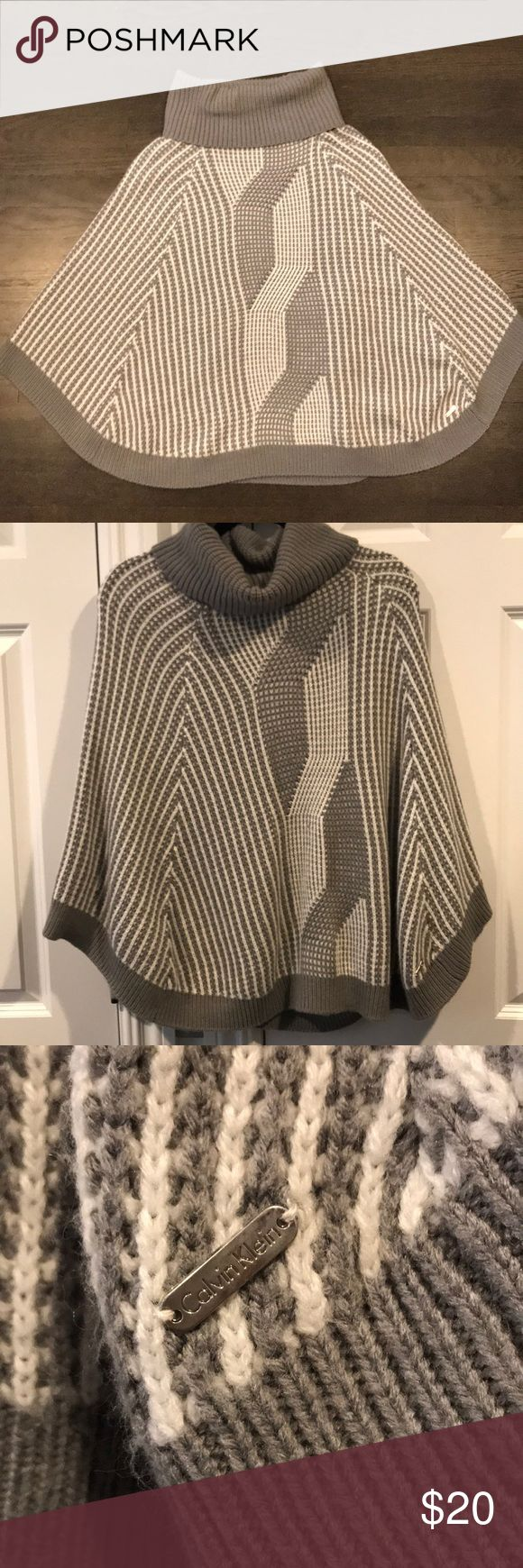 "Calvin Klein cowl neck poncho Calvin Klein gray and white cable knit poncho. Cozy and warm! Pair with a white long sleeve, jeans or leggings and booties for a cute Fall/Winter outfit ☺️ Labeled as ""one size"" I wear a small/medium. Calvin Klein Sweaters Shrugs & Ponchos"
