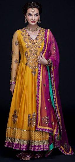 Dia Mirza in a marigold yellow chanderi by Ritu Kumar.